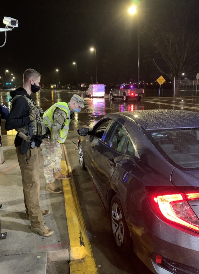 Specialist Jaxon Wright, 163rd Military Police Detachment, 716th Military Police Battalion, speaks with a driver March 17 at a sobriety checkpoint on Fort Campbell. Also pictured is Investigator Avery Neitzel, 163rd MP Co. According to the National Highway Traffic Safety Administration, 28 people in the U.S. die in drunk driving crashes each day. Fort Campbell hasn't added onto that statistic in 2021, and the PMO's sobriety checkpoints may be a factor.