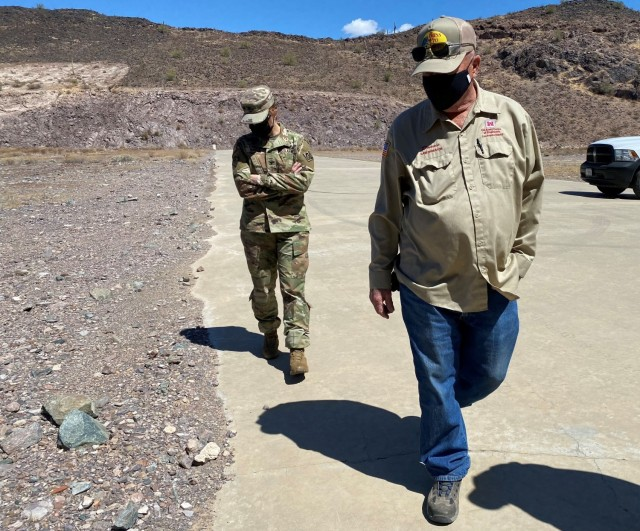 """Donald """"Donnie"""" May, dam operator, briefs Col. Julie Balten, U.S. Army Corps of Engineers Los Angeles District commander, during a tour of the Painted Rock Dam spillway March 24 near Gila Bend, Arizona. The spillway was built to keep flood waters from damaging the dam's structure"""