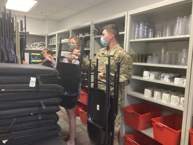 Private Second Class James Barber, 160th Special Operations Aviation Regiment, and his wife, Savannah McMahon, borrow a table, chairs and kitchen utensils March 16 from the Army Community Service-Relocation Readiness Program Lending Closet, 1501 William C. Lee Road. The Lending Closet, located inside ACS at 1501 William C. Lee Road, is just one of the many services the Relocation Readiness Program at Fort Campbell offers for Soldiers and their Families who are arriving or leaving Fort Campbell for a permanent change of station, said Connie Silk, ACS-Relocation Readiness Program manager.