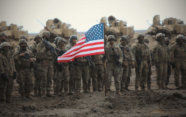 Soldiers from the 2nd Battalion, 5th Cavalry Regiment, 1st Armored Brigade Combat Team, 1st Cavalry Division, represent the United States during the closing ceremony of joint-force exercise Justice Eagle at Smardan Training Area, Romania, March 23, 2021. Poland and Romania also participated in the exercise. (Photo by Spc. Jabari Clyburn)