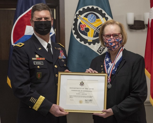K Krewer, chief counsel, U.S. Army Materiel Command Legal Center-Rock Island Arsenal, was presented her certificate of retirement by Maj. Gen. Daniel Mitchell, commanding general, U.S. Army Sustainment Command, during a retirement ceremony held in her honor at Rock Island Arsenal, Illinois, March 26. (Photo by Linda Lambiotte, ASC Public Affairs)