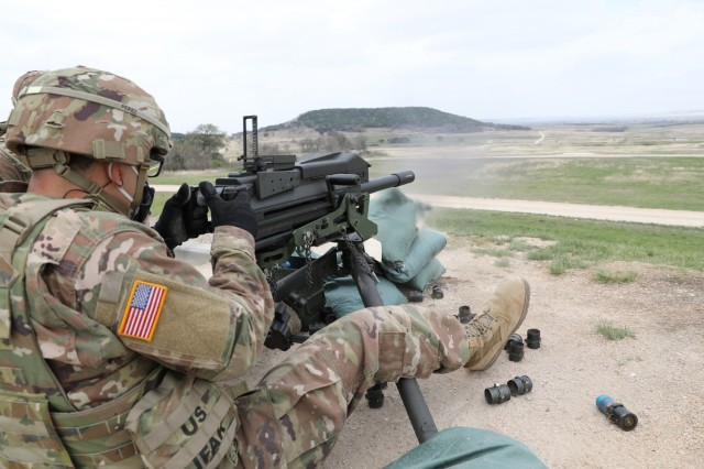 Spc. Christian Perez, Headquarters and Headquarters Company, 40th Combat Aviation Brigade, fires the MK19 grenade launcher, March 17, 2021 at North Fort Hood, Texas. (U.S. Army National Guard photo by Sgt. 1st Class Ryan Sheldon)