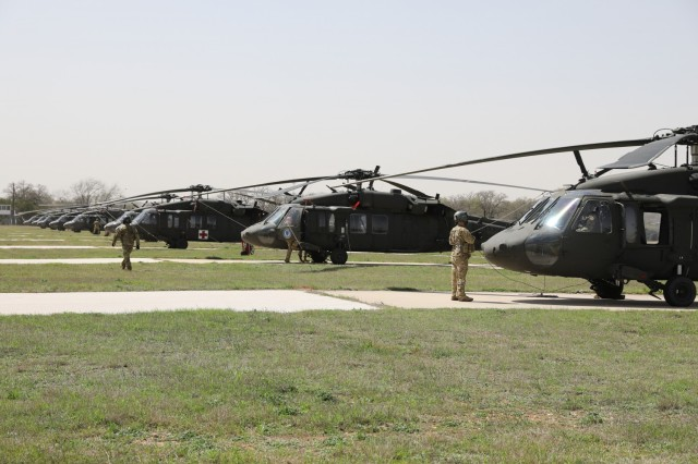 UH-60 Black Hawk helicopters from Task Force Phoenix are parked at Longhorn Auxiliary Landing Strip during pre-deployment training, March 17, 2021 at North Fort Hood, Texas. (U.S. Army National Guard photo by Sgt. 1st Class Ryan Sheldon)