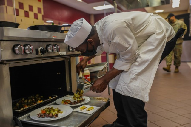 """U.S. Army Sgt. D'sean Wright 326th Brigade Engineer Battalion """"Sapper Eagles"""", 1st Brigade Combat Team, 101st Airborne Division (Air Assault) plates his meal for the judges of the division Cook of the Quarter competition March 18, 2021, at the Division Culinary Lab in Fort Campbell, Kentucky. Wright won Senior Chef of the Quarter for 1st BCT, allowing him to move to the next level of competition. (U.S. Army Photo by Sgt. Lynnwood Thomas, 1st Brigade Combat Team Public Affairs)"""