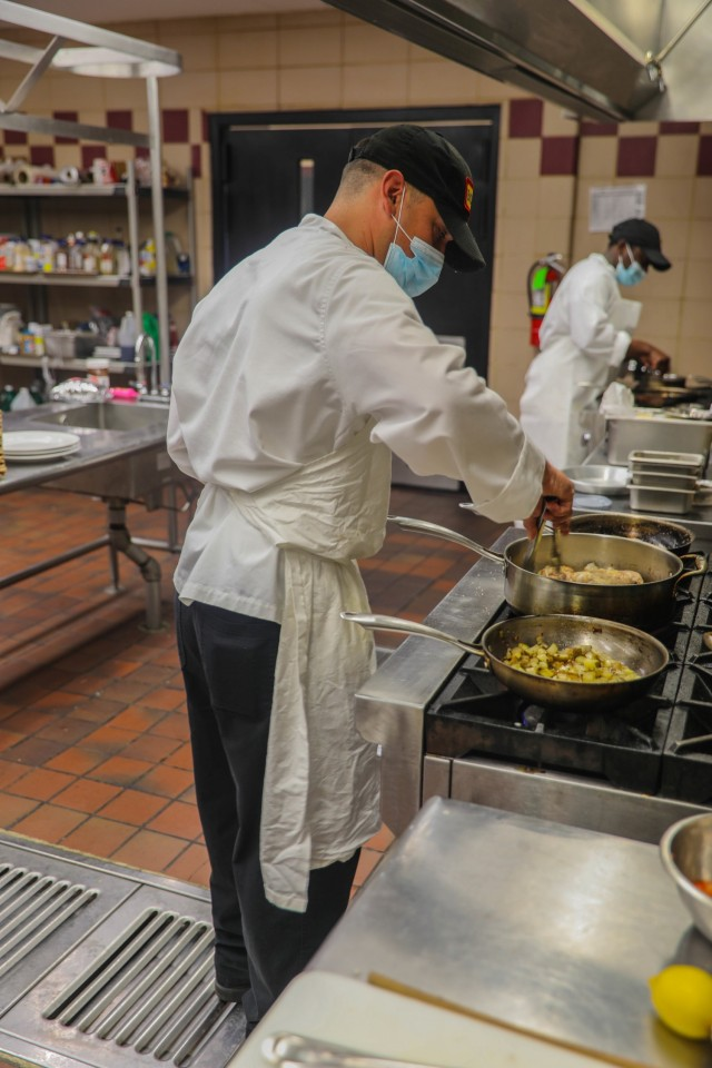 """Pfc. Rafael Robert, culinary specialist, 1st Battalion, 506th Infantry Regiment """"Red Currahee"""", 1st Brigade Combat Team, 101st Airborne Division (Air Assault) prepares his main dish for the division Cook of the Quarter competition March 18, 2021, at the Division Culinary Lab in Fort Campbell, Kentucky. Robert won Junior Chef of the Quarter for 1st BCT, allowing him to move to the next level of competition. (U.S. Army Photo by Sgt. Lynnwood Thomas, 1st Brigade Combat Team Public Affairs)"""