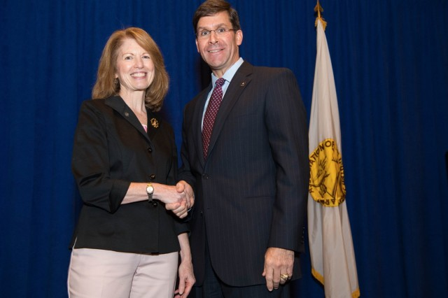 Diane Randon, now the assistant deputy chief of staff, G-2, poses for a photo with former Army Secretary Mark Esper after she received the Army Civilian Service Recognition pin during a ceremony Oct. 16, 2018.