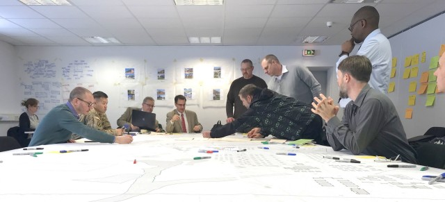 Personnel discuss possible future plans for sections of the camps area of the Grafenwoehr Training Area during collaboration sessions in spring 2019 that were part of creating an Area Development Execution Plan to outline the long-term plan for the area.