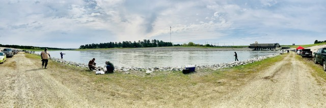 People fishing along river