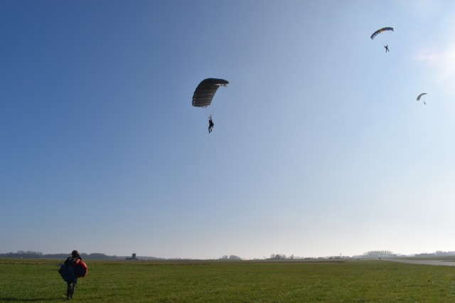 CHIÈVRES, Belgium – Members of the Belgian Special Forces Group take parachute training at the airfield at Chièvres Air Base. For the first time, U.S. Army Garrison Benelux and 424th Air Base Squadron – an Air Force element at the garrison – hosted the Belgian Defense Forces' Paratroopers Training Center as they held training and qualification jumps for their paracommandos March 1, 2021. (U.S. Army photo by Bryan Gatchell, USAG Benelux Public Affairs)