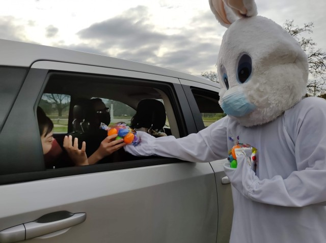 WHINSEC's Easter Bunny (HHC Commander CPT Hiram Figueroa-Cruz) hands out bags of Easter eggs and other goodies to families that participated on the drive-thru WHINSEC Easter Egg Hunt. U.S. Army Photo by Milton F. Mariani Rodríguez