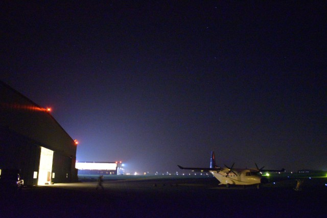 CHIÈVRES, Belgium – Members of the Belgian Special Forces Group runs to a CASA C-212, a medium cargo turboprop aircraft, to perform a night jump onto the airfield at Chièvres Air Base. For the first time, U.S. Army Garrison Benelux and 424th Air Base Squadron – an Air Force element at the garrison – hosted the Belgian Defense Forces' Paratroopers Training Center as they held training and qualification jumps for their paracommandos March 1, 2021. (U.S. Army photo by Bryan Gatchell, USAG Benelux Public Affairs)