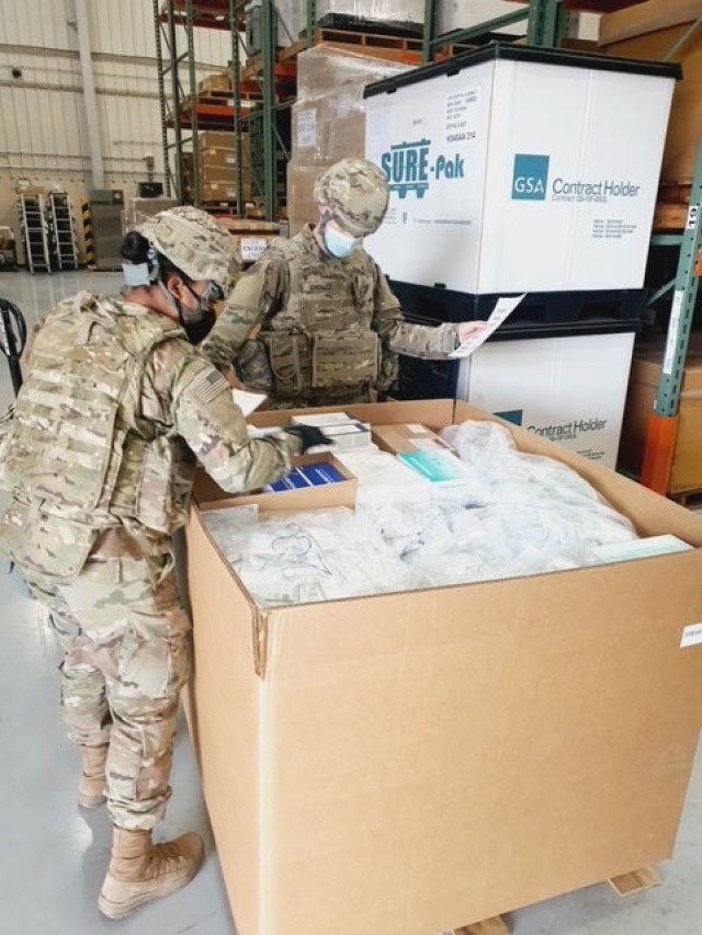 Pvts. Trezia Davenport and Alan Gonzalez, assigned to the 563rd Medical Logistics Company, assemble a tactical combat medical care resupply set in support of U.S. Forces Korea during an exercise at the Army's prepositioned stocks site in South Korea.