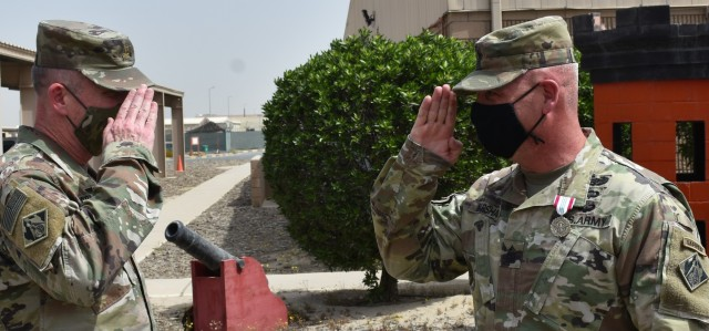 A final salute from Operations Officer in Charge Major Ed Zook to Senior Enlisted Leader SGM Nathan Marshall at Camp Arifjan, Kuwait. (Photo by Rick Benoit)