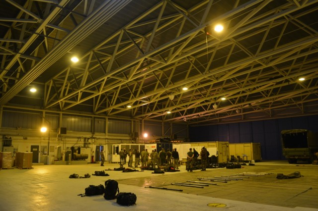 CHIÈVRES, Belgium – Members of the Belgian Special Forces Group conduct a briefing before performing a night jump training. For the first time, U.S. Army Garrison Benelux and 424th Air Base Squadron – an Air Force element at the garrison – hosted the Belgian Defense Forces' Paratroopers Training Center as they held training and qualification jumps for their paracommandos March 1, 2021. (U.S. Army photo by Bryan Gatchell, USAG Benelux Public Affairs)