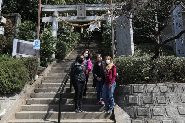 """Megumi Saito, rear left, an instructor for Camp Zama's """"Head Start"""" program, poses with a group of class participants March 18 in front of Zama Shrine during the group's field trip. The Head Start program went on hiatus in the spring of 2020 due to the COVID-19 pandemic, before resuming in July that year for Soldier and civilian sponsors only. The February class marked the return of the spouse-specific program, with measures in place to adhere to group-size and social-distancing regulations."""