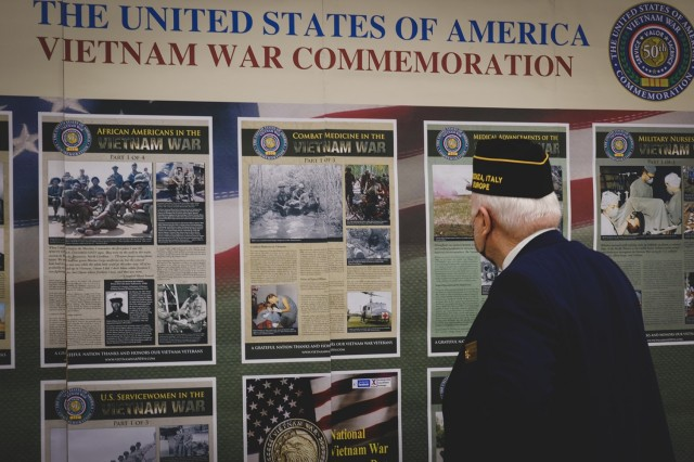 Memories return to Vince Clark, a Vietnam veteran, as he admires imagery from the war during Vietnam War Recognition Day, March 29, 2021 in Vicenza, Italy.