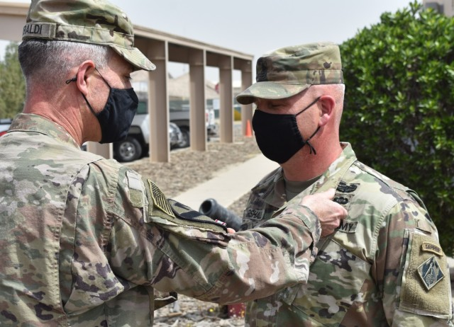 Sergeant Major Nathan Marshall is presented with the Defense Meritorious Service Medal as he prepares to redeploy from the Transatlantic Afghanistan District. (Photo by Rick Benoit)