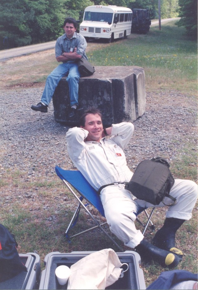 Mr. Steven T. Bird, front, takes a break during ground-breaking work in the1997 XP27 assessment mission at Pine Bluff Arsenal, Arkansas.