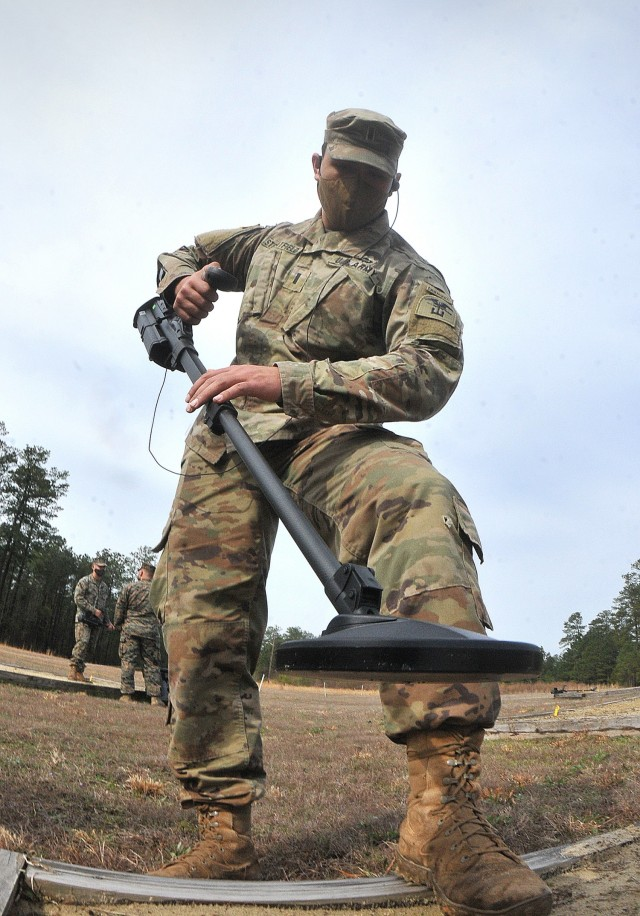 U.S. Army 1st Lt. Samir Streatfield tests his metal detector prior to beginning a basic metal detector exercise during training conducted by the Humanitarian Demining Training Center March 25 at Fort Lee's Training Area 4. Streatfield was one of 26 students enrolled in a course that primarily teaches military personnel how to administer demining training programs.