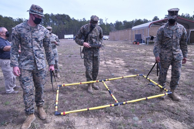 U.S. Marines assigned to the 1st Combat Engineer Battalion, Camp Pendleton, Calif., use wide-area metal detecting equipment during a Humanitarian Demining Training Center class conducted March 25 at Fort Lee.