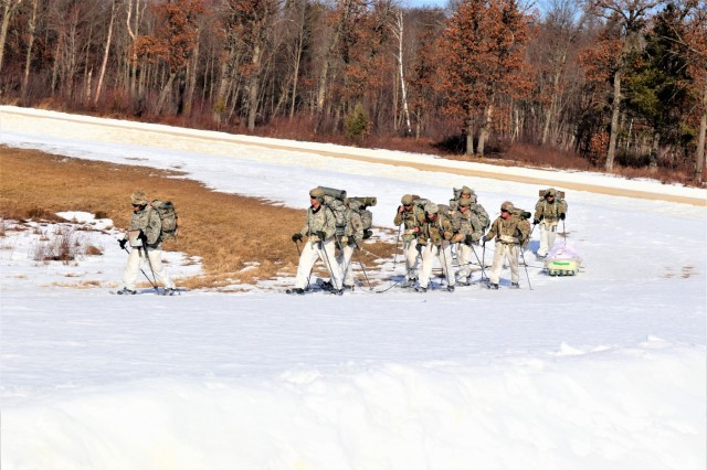 Students in Fort McCoy Cold-Weather Operations Course (CWOC) class 21-04, which mainly was comprised of Airmen, participate in cold-weather training scenario Feb. 26, 2021, on South Post at Fort McCoy, Wis. CWOC students are trained on a variety of cold-weather subjects, including snowshoe training and skiing as well as how to use ahkio sleds and other gear. Training also focuses on terrain and weather analysis, risk management, cold-weather clothing, developing winter fighting positions in the field, camouflage and concealment, and numerous other areas that are important to know in order to survive and operate in a cold-weather environment. The training is coordinated through the Directorate of Plans, Training, Mobilization and Security at Fort McCoy. (Photo by Scott Sturkol, Fort McCoy Public Affairs Office)