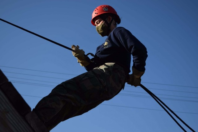 A Wisconsin Challenge Academy cadet participates in rappelling training on the cantonment area March 16, 2021, during training at the academy complex at Fort McCoy, Wis. The academy is a tenant organization at Fort McCoy that is managed by the Wisconsin National Guard. Dozens of youth attend there every year. And during their training, the cadets learn a variety of skills while also learning about teamwork, leadership, and community support. (Photo by Julee Katona, Wisconsin Challenge Academy)