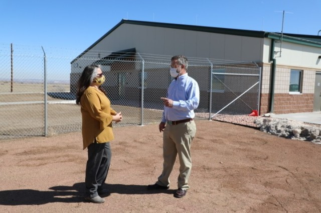 Greg Sipes (right) project engineer and contracting office representative, U.S. Army Corps of Engineers, Omaha District, Fort Carson South office, and Alice Gallegos, Army Supply Point supervisor, talk in front of the ammunition storehouse on Fort Carson, CO, March 19.