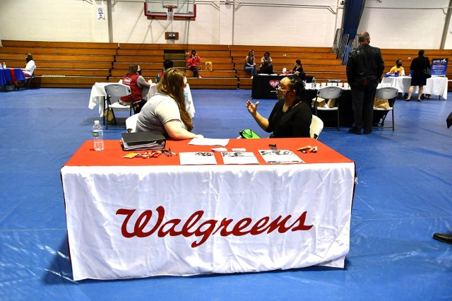 Beth Robson (left), Walgreen's Leesville store manager, interviews military spouse, Juwell Nielsen, at the Fort Polk Military Spouse Employment Fair March 24 at the Youth Gym.