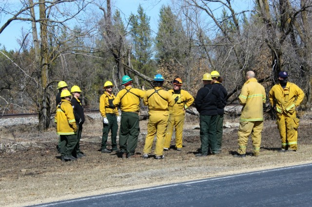 Forestry Technician Tim Parry lights a prescribed burn March 18, 2021, along the railroad tracks on South Post at Fort McCoy, Wis. The post prescribed burn team includes personnel with the Fort McCoy Directorate of Emergency Services Fire Department; Directorate of Public Works (DPW) Environmental Division Natural Resources Branch; Directorate of Plans, Training, Mobilization and Security; and the Colorado State University Center for Environmental Management of Military Lands, under contract with the post. Prescribed burns also improve wildlife habitat, control invasive plant species, restore and maintain native plant communities, and reduce wildfire potential. Prescribed burns benefit the environment many ways and are one of the tools we can use on a large scale to improve our wild habitat, said Fort McCoy Forester Charles Mentzel with the Directorate of Public Works Natural Resources Branch. Mentzel said prescribed burns help set back invasive species, and they burn up their seed banks. Burns also give native species an opportunity to compete against some of the non-native species, as many native species depend on fire to help stimulate them and set back non-native species. (Photo by Scott Sturkol, Fort McCoy Public Affairs Office)