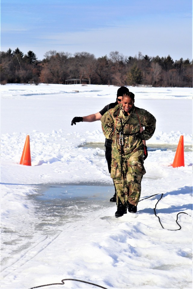 Airman 1st Class Jarva Brown with the 164th Security Forces Squadron at Memphis Air National Guard Base, Tenn., participates in cold-water immersion training Feb. 26, 2021, at Big Sandy Lake on South Post at Fort McCoy, Wis. CWOC students are trained on a variety of cold-weather subjects, including snowshoe training and skiing as well as how to use ahkio sleds and other gear. Training also focuses on terrain and weather analysis, risk management, cold-weather clothing, developing winter fighting positions in the field, camouflage and concealment, and numerous other areas that are important to know in order to survive and operate in a cold-weather environment. The training is coordinated through the Directorate of Plans, Training, Mobilization and Security at Fort McCoy. (Photo by Scott Sturkol, Fort McCoy Public Affairs Office)