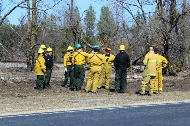 Team members prepare for a prescribed burn March 18, 2021, along the railroad tracks on South Post at Fort McCoy, Wis. The post prescribed burn team includes personnel with the Fort McCoy Directorate of Emergency Services Fire Department; Directorate of Public Works (DPW) Environmental Division Natural Resources Branch; Directorate of Plans, Training, Mobilization and Security; and the Colorado State University Center for Environmental Management of Military Lands, under contract with the post. Prescribed burns also improve wildlife habitat, control invasive plant species, restore and maintain native plant communities, and reduce wildfire potential. Prescribed burns benefit the environment many ways and are one of the tools we can use on a large scale to improve our wild habitat, said Fort McCoy Forester Charles Mentzel with the Directorate of Public Works Natural Resources Branch. Mentzel said prescribed burns help set back invasive species, and they burn up their seed banks. Burns also give native species an opportunity to compete against some of the non-native species, as many native species depend on fire to help stimulate them and set back non-native species. (Photo by Scott Sturkol, Fort McCoy Public Affairs Office)