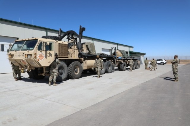 Soldiers from the 138th Infantry Battalion, 1st Striker Brigade turn in extra ammunition at the new ammunition inspection facility on Fort Carson, CO, March 19