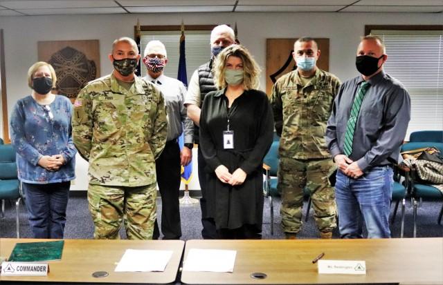 (From left) Fort McCoy Resource Management Officer Maureen Richardson, Garrison Commander Col. Michael Poss, Deputy to the Garrison Commander Brad Stewart, Vernon County Highway Commissioner Phil Hewitt, Vernon County Administrator Cari Reddington, Fort McCoy Staff Judge Advocate Lt. Col. Savas Kyriakidis, and Directorate of Public Works Operations and Maintenance Division Chief Nathan Sobojinski were all on hand for the signeing of an intergovernmental service agreement (IGSA) between the post and Vernon County on March 15, 2021, at Fort McCoy, Wis. The agreement involves line striping on roadways at Fort McCoy and is estimated to save the installation more than $166,000 over the next 10 years. It is the second IGSA the post has made in the last two years. (U.S. Army Photo by Scott T. Sturkol, Public Affairs Office, Fort McCoy, Wis.)