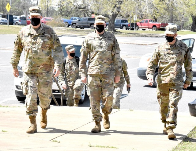 Maj. Gen. Timothy P. McGuire, (left) IMCOM deputy commander, Col. Ryan K. Roseberry, (middle) Fort Polk garrison commander, and Command Sgt. Maj. Christopher Ausbun, garrison command sergeant major, prepare to check out barracks renovations on Fort Polk March 23.