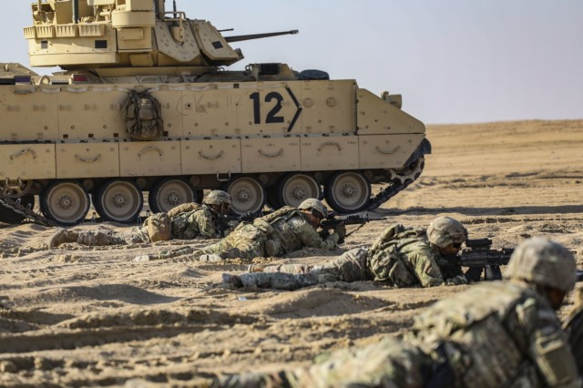 Soldiers with 1st Battalion, 6th Infantry Regiment, and 40th Brigade Engineer Battalion, 2nd Armored Brigade Combat Team, 1st Armored Division conduct a  Combined Arms Live-Fire exercise near Camp Buehring, Kuwait December 20, 2020. 2ABCT was deployed to southwest Asia in support of Operation Spartan Shield. (U.S. Army photo by: Staff Sgt. Michael West)
