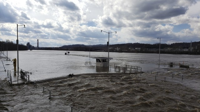 Flood waters forced closure of the Locks and Dams 3 on the Monongahela River in Elizabeth, Pennsylvania, March 1, 2021. High water from snow melts and extended rain affected the U.S. Army Corps of Engineers Pittsburgh District on the Monongahela River in early March. Elizabeth Locks and Dams (L/D 3) was taken out of service as water entered the operating machinery and topped the lock walls. The average time of high-water stopping operation was 30 hours. The lock staff cleared mud and debris, and each lock was returned to service within eight hours of water receding. Elizabeth is one of the oldest functioning locks in the nation, 114 years old. (U.S. Army Corps of Engineers Pittsburgh District Photo by Philip Delo)