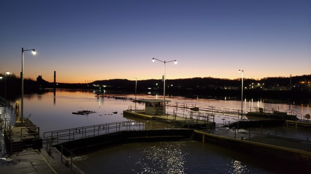 The waters recede after a flood incident at the Locks and Dams 3 on the Monongahela River in Elizabeth, Pennsylvania, during sunset, March 2, 2021. High water from snow melts and extended rain affected the U.S. Army Corps of Engineers Pittsburgh District on the Monongahela River in early March. Elizabeth Locks and Dams (L/D 3) was taken out of service as water entered the operating machinery and topped the lock walls. The average time of high-water stopping operation was 30 hours. The lock staff cleared mud and debris, and each lock was returned to service within eight hours of water receding. Elizabeth is one of the oldest functioning locks in the nation, 114 years old. (U.S. Army Corps of Engineers Pittsburgh District Photo by Philip Delo)