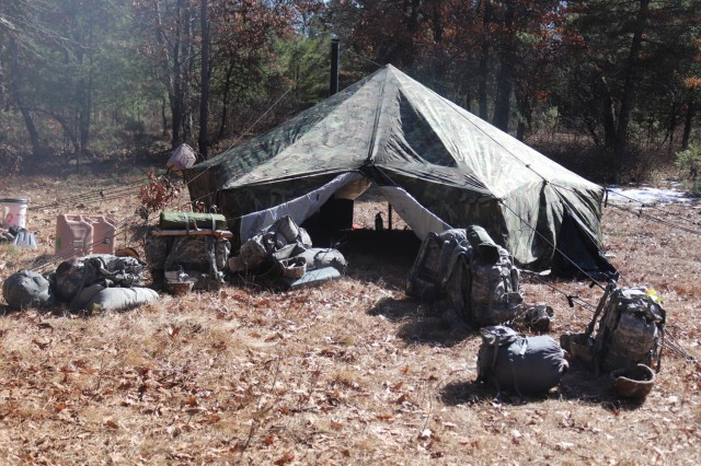 A tent set up by students in Fort McCoy Cold-Weather Operations Course (CWOC) class 21-05 during shelter-building training is shown March 11, 2021, at Fort McCoy, Wis. CWOC students are trained on a variety of cold-weather subjects, including snowshoe training and skiing as well as how to use ahkio sleds and other gear. Training also focuses on terrain and weather analysis, risk management, cold-weather clothing, developing winter fighting positions in the field, camouflage and concealment, and numerous other areas that are important to know in order to survive and operate in a cold-weather environment. The training is coordinated through the Directorate of Plans, Training, Mobilization and Security at Fort McCoy. (Photo by Scott Sturkol, Fort McCoy Public Affairs Office)