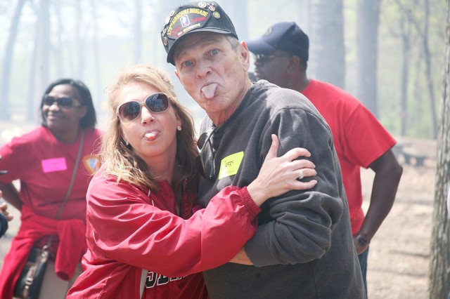 Kerrie Branson, Survivor Outreach Services coordinator for Redstone Arsenal, Alabama, playfully poses with Perry Ramsey, whose son was killed in Afghanistan in August 2011, during a U.S. Army Space and Missile Defense Command-sponsored Spring Fling for Gold Star Families at Monte Sano State Park in Huntsville, Alabama, April 11, 2015. (U.S. Army photo by Carrie David Campbell)