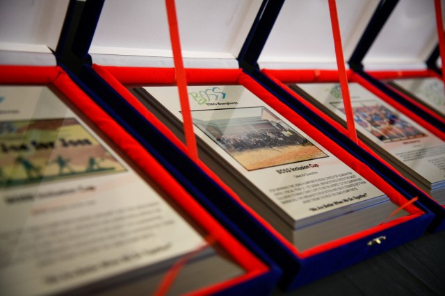 CAMP HUMPHREYS, Republic of Korea - Plaques and awards are lined up and prepared for presentation during a Better Opportunity for Single Soldiers (BOSS) awards ceremony here, March 24. Representatives and BOSS members from across Humphreys are essential in the planning, implementation and success of the numerous programs, events and initiatives conducted by the program, designed to improve the quality of life of single and unaccompanied Soldiers. (U.S. Army photo by Spc. Matthew Marcellus)