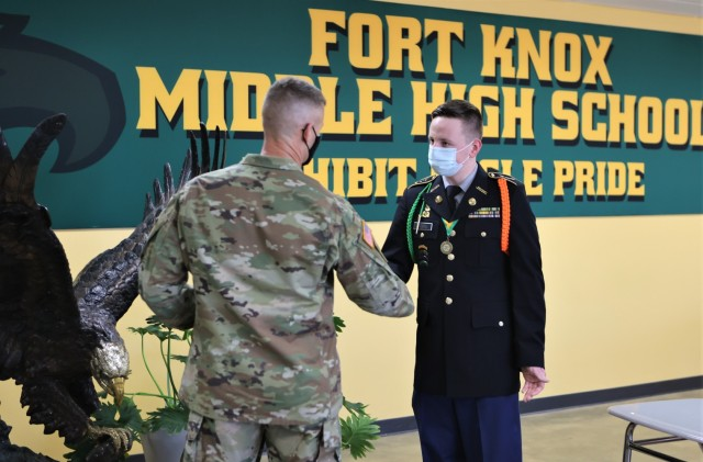 """A Fort Knox Middle High School senior has been honored with a West Point appointment – this in addition to a four year ROTC scholarship.  Mark Cecil is still weighing what will be the best fit for him though, as he prepares to study mechanical engineering.  """"I have not made my decision yet,"""" said Cecil, who is also considering Texas A & M University. """"I have to make my decision by May 1, but it's a great honor to have received an appointment to West Point.""""  Garrison Commander Col. C.J. King joined Cecil and school faculty Thursday to celebrate the young man's achievement.   """"The fact that you've been extended the offer is incredible,"""" said King. """"I hope you take it but if you don't, I hope you're successful in all you do."""""""