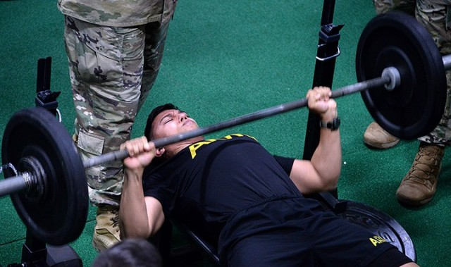 Sgt. Gilberto Garcia, 256th Military Police Company, 40th MP Battalion (Detention), performs bench press repetitions in the Iron Griffin fitness challenge during the 15th MP Brigade NCO and Soldier of the Year competition March 25 in the company operations facility. Garcia was named NCO of the Year for the 40th MP Battalion and will go on to represent Fort Leavenworth in the Combined Arms Center competition. Photo by Prudence Siebert/Fort Leavenworth Lamp
