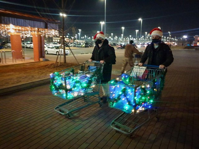CAMP HUMPHREYS, Republic of Korea - Spc. Ian Holmes, the Humphreys Better Opportunities for Single Soldiers (BOSS) President and a CH-47 helicopter repairer assigned to Installation Management Command (IMCOM), left, and Spc. Austin Gano, the BOSS Vice President and Patriot Fire Control Enhanced Operator assigned to IMCOM, push holiday decorated shopping carts here, as they support BOSS initiatives and events, Dec. 2020. The Humphreys BOSS program aims to provide unique opportunities and events for single and unaccompanied Soldiers across Humphreys, ensuring that they have ample opportunity to meet new friends, build morale, and enjoy their duration in Korea. (Courtesy photo provided by Spc. Ian Holmes)