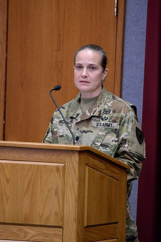 Guest speaker Lt. Col. Corrie Hanson, 705th Military Police Battalion (Detention) commander, speaks to the small in-person audience and the larger online audience watching on Facebook during the Women's History Month observance March 26 in Grant Auditorium. Photo by Prudence Siebert/Fort Leavenworth Lamp