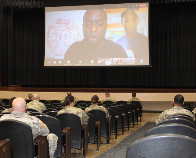 1st Theater Sustainment Command soldiers and civilian employees watch a presentation from Poet and Sexual Violence Prevention Advocate Obbie West at Olive Theater at Fort Knox, Kentucky, March 29, 2021, kicking off Sexual Assault and Awareness Prevention Month.
