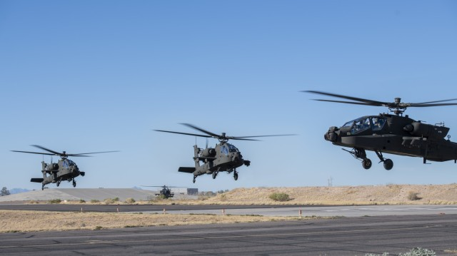 AH-64E version 6 (V6) Apache helicopters takeoff from the Boeing facilities at Mesa, Ariz., bound for Joint Base Lewis-McChord (JBLM), Wash. PEO Aviation's PM Apache New Equipment Training Team conducts computer based and hands-on training as part of the certification process to fly and maintain the Apache AH-64E Version 6 Apache helicopter. The training ensures pilots and maintainers of AH-64E version 4 or earlier aircraft are fully qualified to operate and maintain the newest version of the Apache helicopter.  (Photo Courtesy Boeing Company)