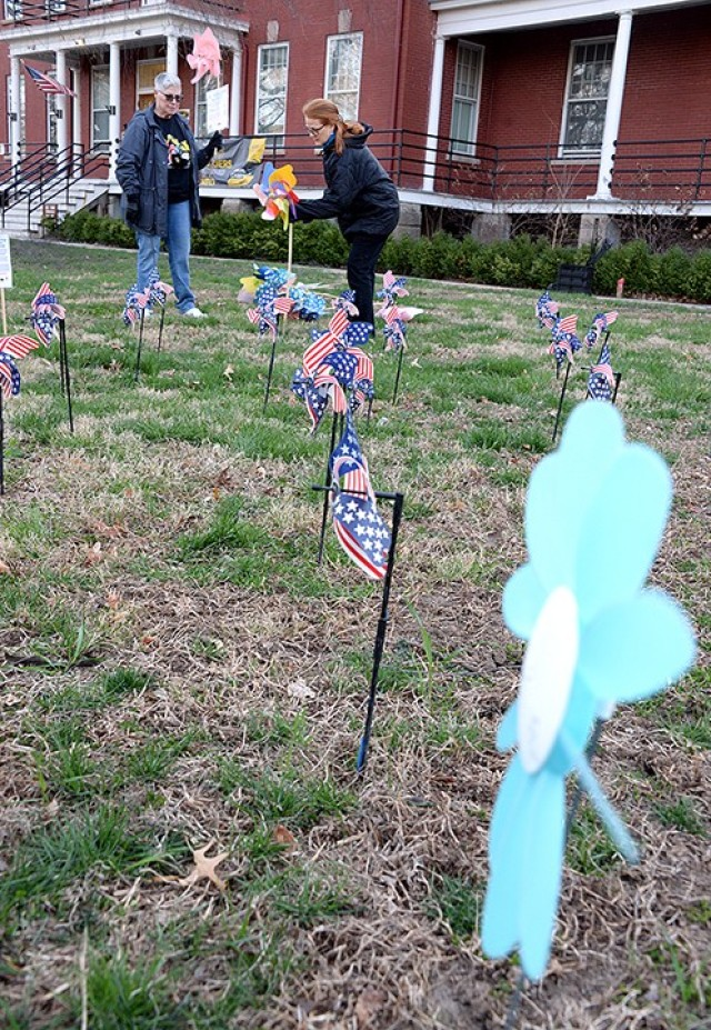 Jayne Meath, Family Advocacy Program specialist, and Tricia Green, domestic violence victim advocate, arrange pinwheels on the front lawn of the Resiliency Center for a Pinwheels for Prevention pinwheel garden March 31. April is Child Abuse Prevention and Awareness Month. The garden's purpose is to help raise awareness about child abuse and neglect and remind the community that Army Community Service's Family Advocacy Program is available to help at-risk families and children. To report child abuse, call 684-2111. To contact FAP representatives, call 684-2822/2808. Photo by Prudence Siebert/Fort Leavenworth Lamp