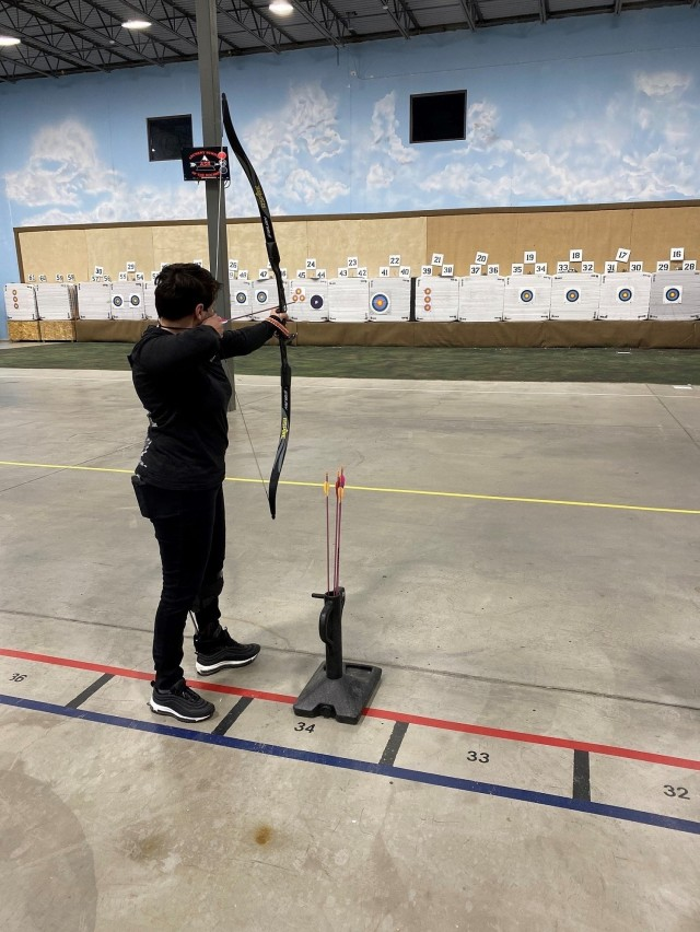 Maj. Adriana de Julio took aim at a target at the Archery School of the Rockies on March 11, 2021. She competed in archery, air rifle and cycling events in the 2021 Army Trials. (Photo courtesy of Courtney Medeiros)