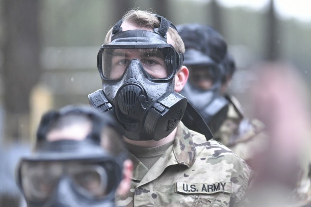 Soldiers of the 217th Military Police Detachment wait to enter the gas chamber during training conducted April 1 at the Fort Lee range complex. Demonstrating the ability to quickly and correctly use chemical, biological, radiological and nuclear protective gear is part of the unit's annual training requirements. (U.S. Army photo by T. Anthony Bell).
