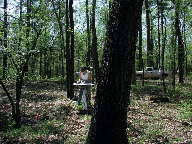 Linda Carnes-McNaughton, program archaeologist and curator, Fort Bragg's Cultural Resources Management Program, Directorate of Public Works, working in the field mapping the John Lamont home site on Fort Bragg, 2005.
